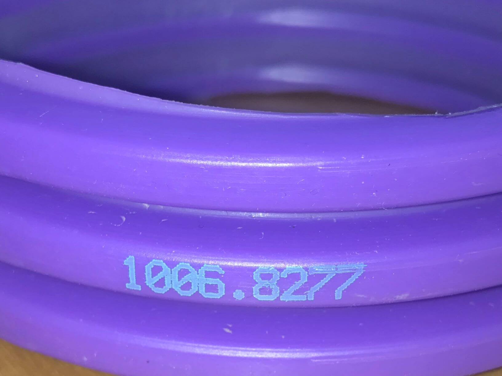 alphaJET industrial inkjet green ink purple pipe